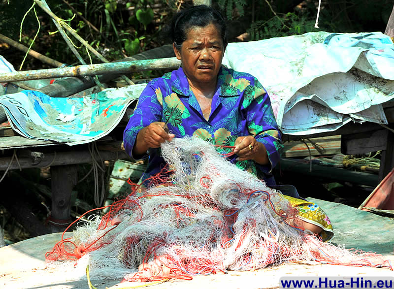 Repairing fishing net in Khao Takiab