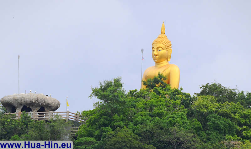 Huge golden Buddha stands at Khao Tao